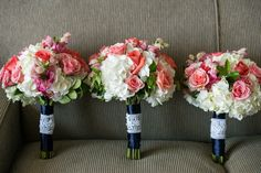 White, Pink, and Coral Wedding Bouquets with Navy Satin Wraps