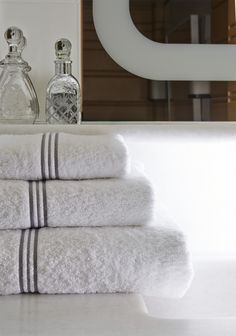 TRIPLO BOURDON -  Stylish and colorful, our Triple Bourdon Bath Collection is a perfect accent to any decorative theme. Three embroidered stripes and a cotton sateen border add a distinctive look to these thick, super plush terry towels.