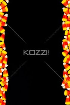 image of a arranged candy corns. - Close-up image of arranged candy corns.