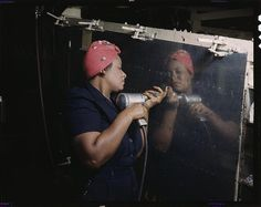 A woman working on a dive bomber in Tennessee, 1943. | 18 Stunning Photos Of Black Women At Work During World War II
