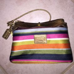 """Coach Stripe Turnlock Wristlet 7.5"""" x 5.5"""" Turnlock Wristlet. Bright and fun striped pattern. Turnlock at the top makes it secure. Strap can be a Wristlet or changed to be a small purse. Perfect for carrying your phone and wallet, larger than a traditional wristlet. Gold accents Coach Bags Clutches & Wristlets"""