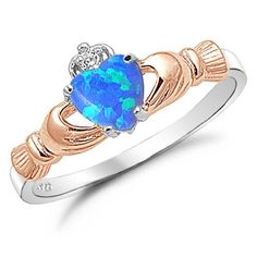 Sterling Silver Heart Shaped Blue Lab Opal Rose Gold Plated Claddagh Ring Size 4 Kriskate & Co. http://www.amazon.com/dp/B008UX8WYU/ref=cm_sw_r_pi_dp_PcBdvb1AH5JAY