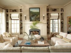 fireplace with flanking windows