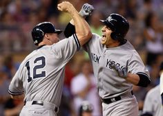With feeling -  Chase Headley of the New York Yankees congratulates teammate John Ryan Murphy on a three-run home run against the Minnesota Twins during the ninth inning July 25 in Minneapolis. The Yankees won 8-5. -  © Hannah Foslien/Getty Images