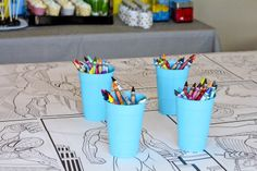 Cover table with super hero coloring pages (print a border on the pages and arrange so they look like a comic book)