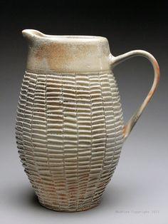Dyann Myers Shino Pitcher  carved, wheel thrown porcelain