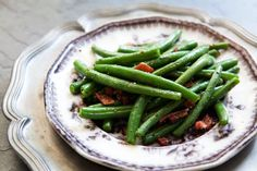 Lightly blanched fresh green beans sauted in bacon fat and served with a little bacon, black pepper and either vinegar or lemon juice.