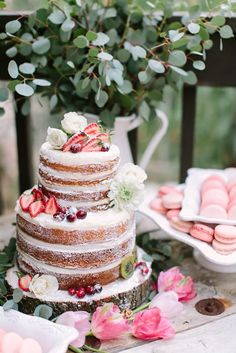 Naked wedding cake. I was at first opposed to this idea but I do believe it's growing on me... and fast. I wouldn't at all mind having this as my wedding cake. Simpler yet still elegant.