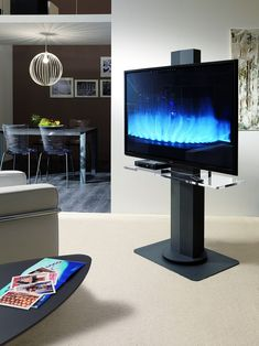 Uno sleek TV stand with adjustable height by Ozzio Italia. Swivel structure in painted metal or stainless steel, available with vitrex shelf. Living Room Wall Units, Ikea Living Room, Swivel Tv Stand, Tv Rack, Italia Design, Tv Wall Design, Wall Mounted Tv, Stand Design, Design Design