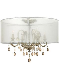 Authentic silver leaf, applied over gold and highly distressed, gives this elegant ceiling light a softly shimmering quality. The delicate wrought iron frame is draped with pearlescent amber crystals, which create a subtle sparkling effect. Wrapped in a translucent organza shade, it's a lovely and feminine accent for your living room, bedroom or foyer