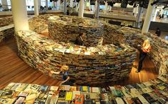 LOST AND BOUND People explore a labyrinth of 250,000 second-hand and new books, entitled aMAZEme, at The Clore Ballroom in the Royal Festival Hall in London. (Photo: Tony Kyriacou / Rex Features via The Telegraph)