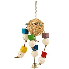 Balls and Blocks Parrot Toy Rattling and chiming crunchy parrot toy.   Large woven vine ball in the centre with lolly pop sticks, leather string tentacles, wiffle balls and wooden blocks offer a miriad of materials, textures and tastes to tantalise the inquisitive mind of your bird.  The vine ball is crunchy and muncy inviting your bird to chew. Inside it there are lolly pop sticks - ideal for your bird to pull out and hold in their foot and chew.
