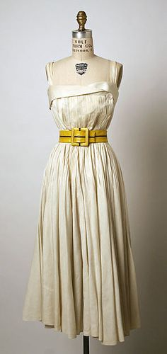 Dress (image 1) | House of Schiaparelli | French | 1951 | linen, leather | Metropolitan Museum of Art | Accession Number: C.I.55.76.3a–c