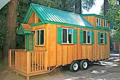 tiny home on wheels with green roof