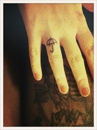 Umbrella finger tattoo