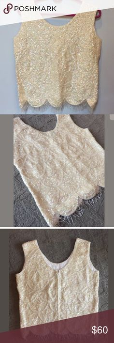 HONG KONG Ivory Scallop Beaded Shell Top. Size M Vintage 1950's HONG KONG Ivory Scalloped Beaded Shell Tank. Size Medium. Great preowned condition. Garment is dated from the 1960's/70's•No areas of missing beading or sequin, rips, holes. There is a slight discoloration on the interior lining if the top. It cannot be seen when the top is worn & has not effected garment In any way. The discoloration is extremely common &is expected from this style & age of clothing.-absolute jaw dropper…