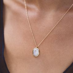 gold necklace, cameo necklace, moonstone, necklace on chest