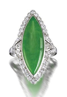 A jadeite and diamond ring The bright green marquise-cut jadeite cabochon of good translucency, measuring approximately 25.2 x 8.8 x 3.1mm, within a single-cut diamond surround, mounted in platinum, diamonds approximately 0.80 carat total