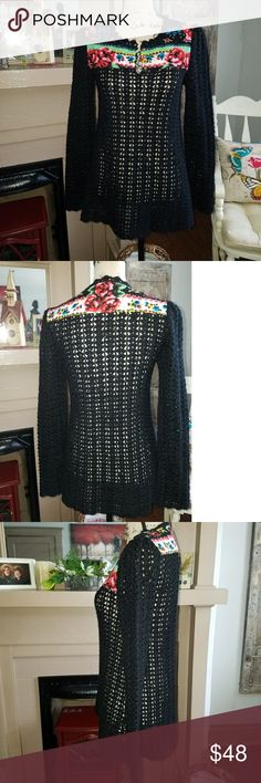 Free People crocheted pullover sweater Beautiful black pullover sweater has open packet at top of neck front with 4 burnish gold round buttons to leave open or button. Long sleeves. Upper detailing at top in front and back of quilted multicolors as show in pictures. Mint condition. Smoke free/pet free home. No trades. I only deal through Poshmark. Free People Sweaters V-Necks