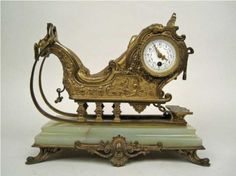 An ormolu and onyx mantel clock in the form of a sleigh. French, 19th Century.