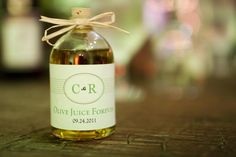 The Olive Oil wedding favor I made, SUPER EASY! Bottles from Sunburst Bottle company,and lables from Vistaprint.