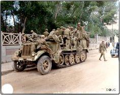 Deutsches Afrika Korps (DAK) prisoners in a Luftwaffe Sd.Kfz.7 Krauss-Maffei Half Track (WL-35239) having surrendered to the British 7th Armoured Division in Tunis. May 1943.