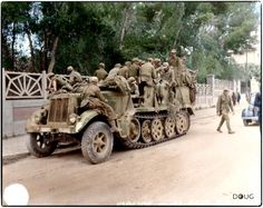 Deutsches Afrika Korps (DAK) prisoners in a Luftwaffe Sd.Kfz.7 Krauss-Maffei Half Track (WL-35239) having surrendered to the British 7th Armoured Division in Tunis. May 1943.