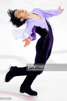 Daisuke Takahashi of Japan competes in the Figure Skating Men's Free Program during day six of the Torino Winter Olympics at Palavela on February 16...