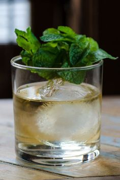 7 Whiskey Cocktails for St. Patrick's Day - Irish Whiskey Drinks - Old Fashioned Emerald - Mixed with the strong herbal and floral zests of appropriately green Charteuse and Dolin Génépy des Alpes (an Alpine shrub-flavored liquor that recently became available in the U.S.), one sip of this cocktail and you will definitely be feeling European on St. Patty's Day if you aren't already. Click through redbookmag.com for more cocktails to whip up this St. Patty's Day.