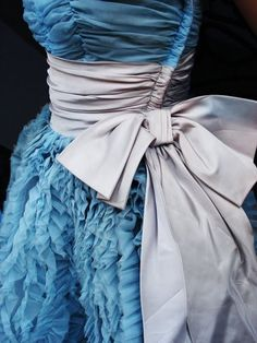 this dress is breathtaking, and i love the dove gray color choice for the sash.