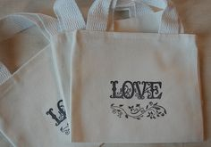 "Black and White Love Cotton Mini Canvas Bag Great for Bridesmaids, Weddings, Parties 5"" x 6"". $3.30, via Etsy."