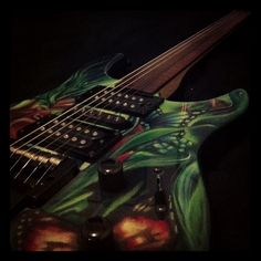 Hand painted guitars Painted Guitars, Guitar Painting, Cartoon Characters, Hand Painted