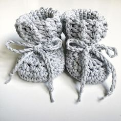 Sustainably and ethically made in Britain. Cotton baby booties handmade from a lovely soft 100% cotton yarn, with matching cotton tie. A beautiful new baby gift. They are available in sizes 0-3, 3-6, 6-12 and 12-18 months, and various colours. These booties are a classic and simple design.
