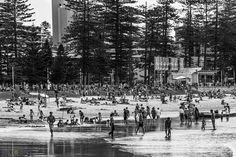 Spring in Sydney is not normally this warm, however November 3rd 2013 was the first real taste of summer for the year. A warm north westerly breeze pushed the temperatures up and the beach was definitely the place to be. With a low tide in the afternoon I headed down to the busiest part of the beach to photograph everyone enjoying the sunshine and warm summer-like air. #monochrome #manly #manlybeach