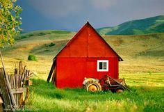 Red barn in a field in the Heber Valley, Utah