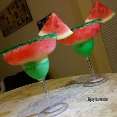 Kiwi Watermelon Twisted Lemonade (1 1/2 oz Kiwi Liqueur 5 oz Lemonade 3 oz Watermelon Juice 1 oz Smirnoff Sours Watermelon Vodka)