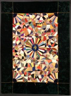 """Victorian Crazy Quilt: Circa 1890; Pennsylvania    Unusual Victorian Crazy Quilt with Dresden Plate center medallion and the initial """"B"""". A fan, that looks like a partial Dresden Plate, is in each corner making for a very orderly crazy quilt, if that is not an oxymoron. Orange bows repeat the color of the embroidered frame."""