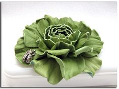 Handcrafted green leather rose (flowers, accessories, brooches, suede, DIY, silver charm, ladybug) http://www.leatherblooms.com/2013/03/18/repetition-week/: