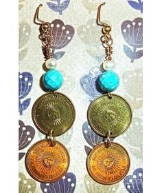 This pair of Double Coin Earrings were handcrafted from retro 2005 Uncirculated Argentinian 5 Centavo coins featuring freshwter pearls and natural turquoise $33.00  http://www.thesoulshoppe.com/earrings/2508-argentina-2005-uncirculated-5-centavos-double-coin-earrings-with-pearls-and-turquoise.html
