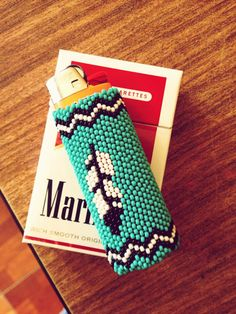 Beaded Lighter Cover. My lighter would be sitting next to a blunt, lol not ciggs!!   #tribal #bohemian #hippie