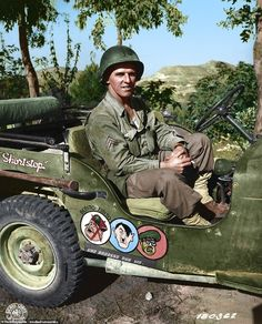 This image captures US Army Corporal Paul F. Janesk sitting in his Jeep in Sicily during the Second World War. The cartoon images on his vehicle show Mussolini crossed out Military Jeep, Military Vehicles, Jeep Names, Willys Mb, Jeep Tj, Military Pictures, War Photography, Military History, Us Army