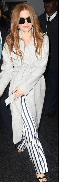 Who made  Isla Fisher's gray belted coat?