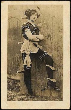 vintage postcards Watch Out!  A female knife thrower on a postcard. Cool!
