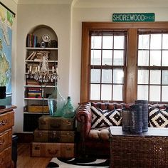 I love the wood door and side table that is made out of old luggage bags.