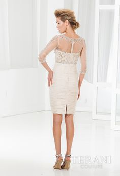 Cocktail dress with rouched skirt and swetheart neckline, the top is finished with an embellished mesh overlay feauturing 3/4 sleeves