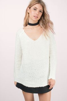 Drop low in the Scoop You Up Sweater. Scoop neck sweater with a low, open back. Wear with leggings and boots for a cozy look.