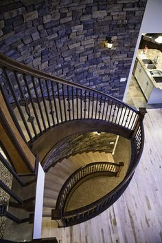 Custom Made Kautz - Tri-Story Curved Staircase by Prestige Railings & Stairs Inc. / Rise and Run Inc.