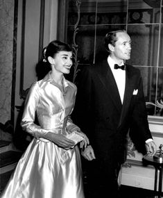 Audrey Hepburn and Mel Ferrerat the Lido Nightclub in Paris,France.  December 19, 1955