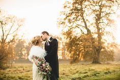 bride and groom kissing at sunset  by Tobiah Tayo Photography