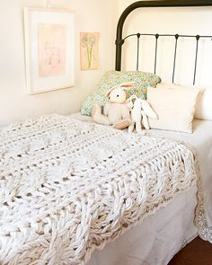 The idea that you can make this gorgeous cable-knit blanket with just your arms and a pile of yarn still makes me giggle. How chic would this look as a throw on your sofa? Cables are an easy, traditional pattern, but the large scale is disarmingly modern.